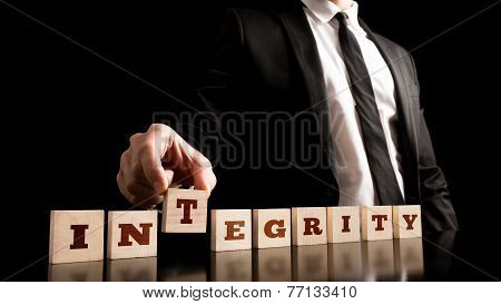 Integrity On Wooden Piece Arranged By Businessman