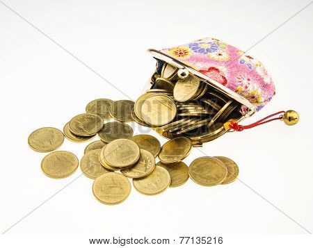 Gold Coins Spilling From Pink Purse