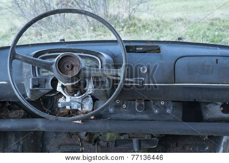 old car abandoned , dashboard and steering whee