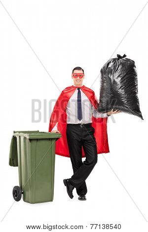 Full length portrait of a superhero holding a large trash bag isolated on white background