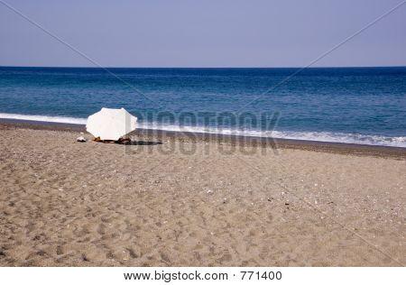 lonely umbrella on beach