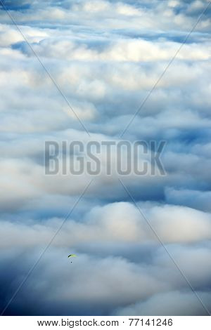 Paragliding over a sea of clouds, El Teide National Park, Spain, Europe
