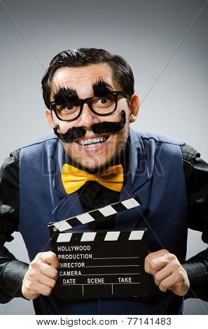 Funny man holding movie clapper