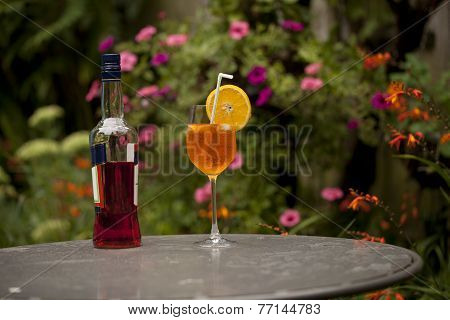 A Bottle of Aperativo and a glass of cool spritzer