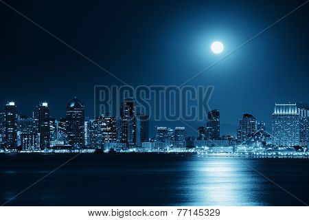 San Diego downtown skyline and full moon over water at night in BW