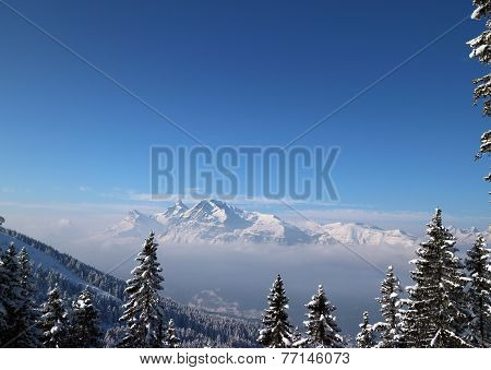 Misty snow Capped Alpine Mountain View on a clear day