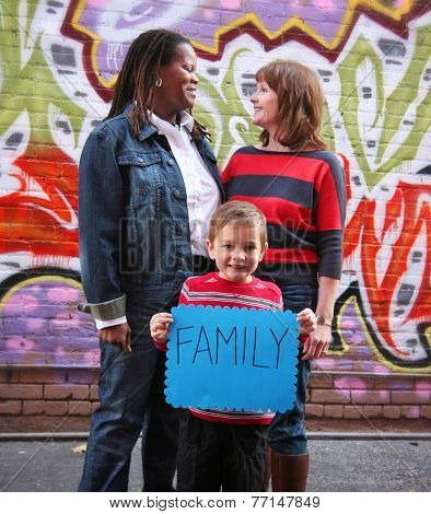 a cute family holding a sign that read family