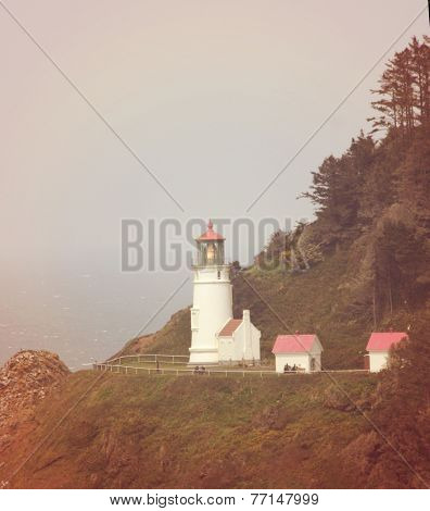 a lighthouse on the cliffs toned with a soft retro vintage instagram filter effect