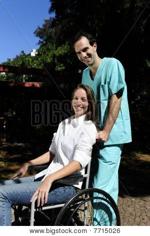 Healthcare Worker Pushing A Woman In A Wheelchair