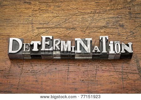 determination  word in mixed vintage metal type printing blocks over grunge wood