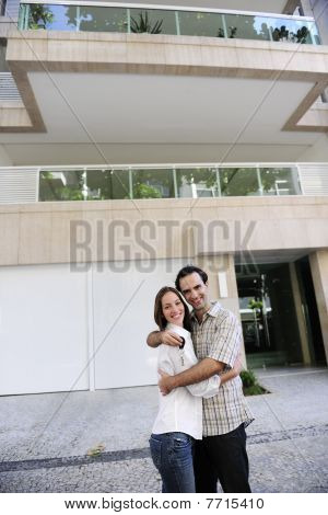 Couple Standing In Front Of Their New Flat