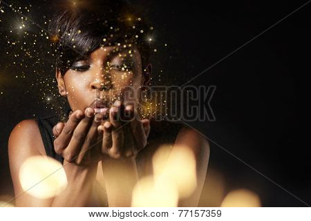Beauty Woman Blowing Golden Dust To The Camera