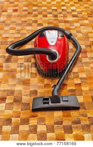 Vacuum cleaner on carpet - technology housework