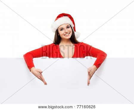 Young and attractive teenager girl with a blank billboard isolated on white background