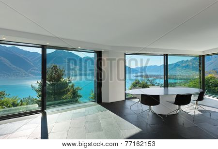 Interior, modern house, wide dining room with glass walls