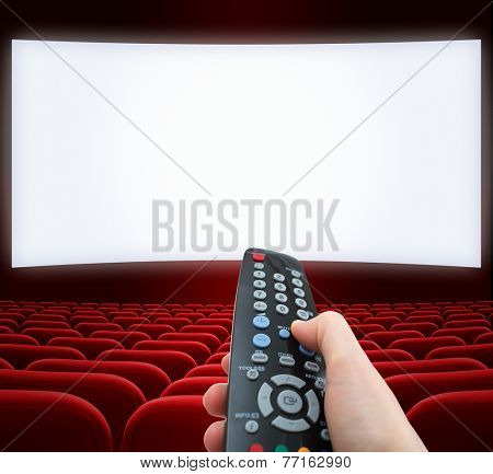 cinema screen with remote control in hand