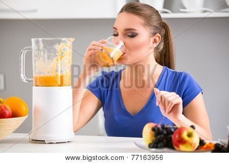 Young girl drinking tasty juice, healthy  fruits smoothies