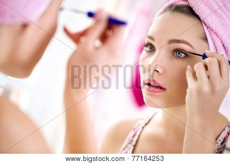 nice beautiful girl make up  front mirror