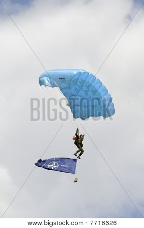 The Parachutist Goes Down With The Nato Flag