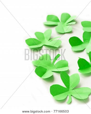 paper green leaves of clover - a symbol of St. Patrick's Day