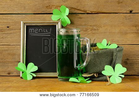 St Patrick's Day green beer with shamrock and   bag of gold coins