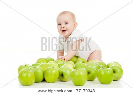 Smiling baby and many green apples