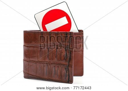 crocodile wallet and stop sign