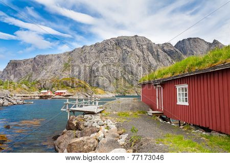 Typical red rorbu fishing hut in village Nusfjord