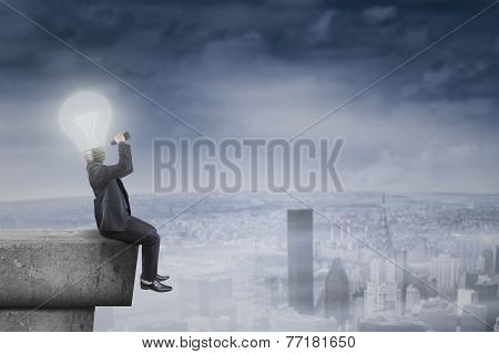 Businessman With Lightbulb Head On Roof