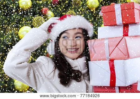 Joyful Girl Holding Christmas Presents