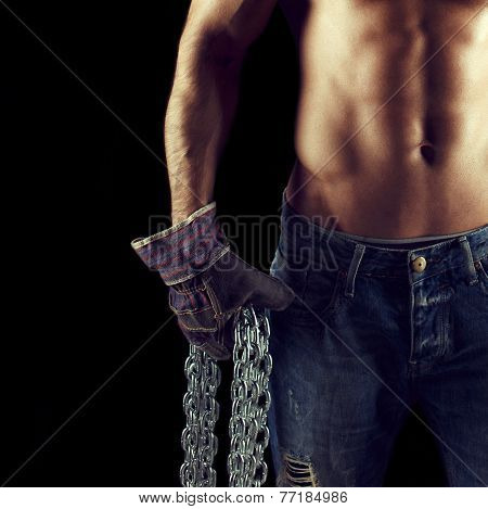 Sexy Macho Man Holding Chains In Gloves