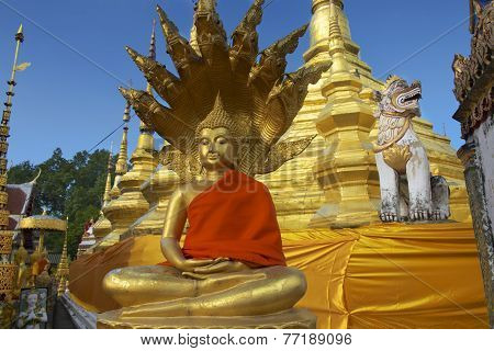 Buddha statue in red at Wat Boromthat Tak Thailand.