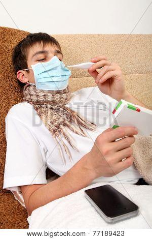 Sick Teenager Looking On Drug Box