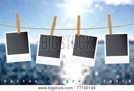 vector blank photos on rope with blurry clouds