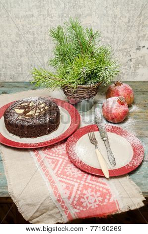 Still Life With Chocolate Cake, Christmas Tree And Pomegranate