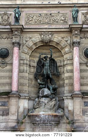 PARIS, FRANCE - NOVEMBER 08, 2012: Fountain Saint-Michel at Place Saint-Michel in Paris. It was constructed in 1858-1860 during French Second Empire by architect Gabriel Davioud and Francisque Duret.