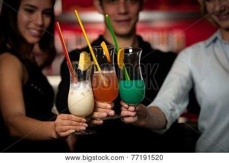 Group Of People Gathering In Cocktail Bar And Having Fun