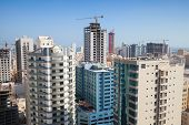stock photo of bahrain  - Modern office buildings and hotels are under construction in city Manama City Bahrain - JPG