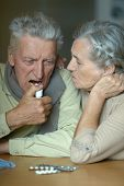 image of influenza  - Elderly caucasian couple ill with influenza at home - JPG