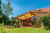 picture of canopy roof  - View from summery nature garden into a cosy winter garden - JPG