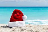 stock photo of santa claus hat  - Santa Claus hat at caribbean sandy beach Cancun - JPG