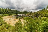 foto of west village  - Traditional village on a river bank in the remote Mamasa Valley West Tana Toraja South Sulawesi Indonesia - JPG