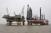 stock photo of oil rig  - Offshore Production And Drilling Platforms Working Together - JPG