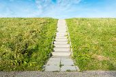 picture of dike  - A concrete staircase between the grass of a dike on a sunny day in autumn - JPG