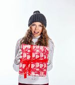 foto of knitted cap  - Cute teen girl in a knitted cap and sweater holds in her hands Christmas gifts - JPG