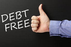 stock photo of debt free  - Male hand in a business shirt giving the thumbs up gesture to the phrase Debt Free written on a blackboard - JPG