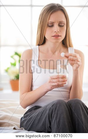 Woman Taking Aspirin.