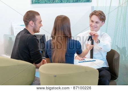 Couple communicating with a salesman