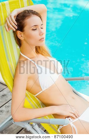 Beauty Relaxing By The Pool.