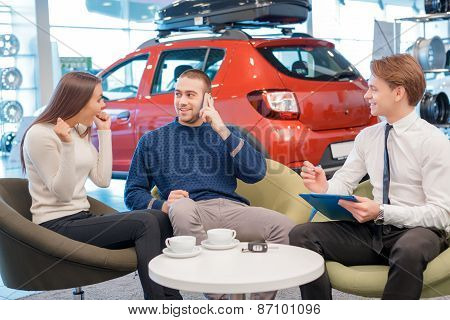 Couple communicating with the salesman in showroom